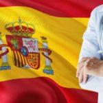 スペインの旗と医者